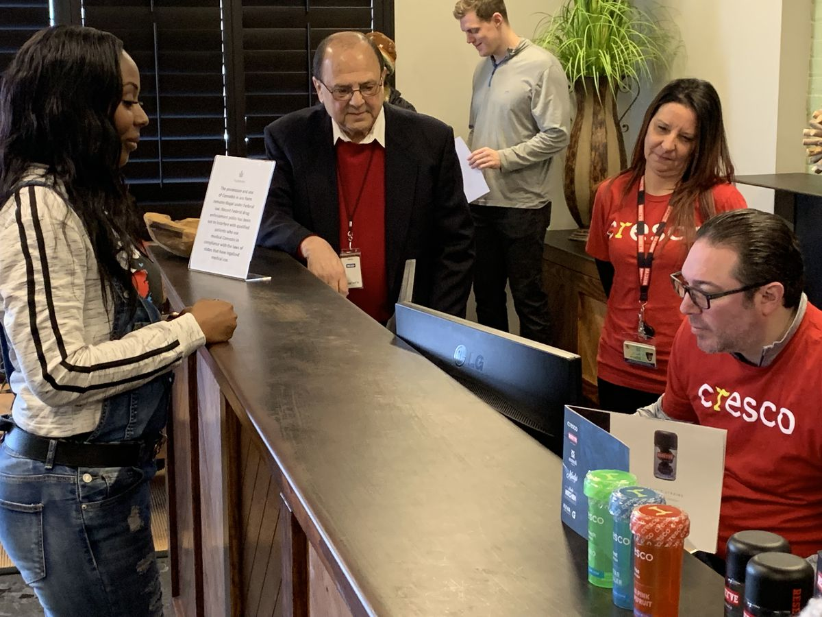 Tashena Altman, one of the first people covered by the Illinois' Opioid Alternative Pilot Program, checks in Friday morning at a medical marijuana dispensary in Elmwood Park.   Tom Schuba/Sun-Times
