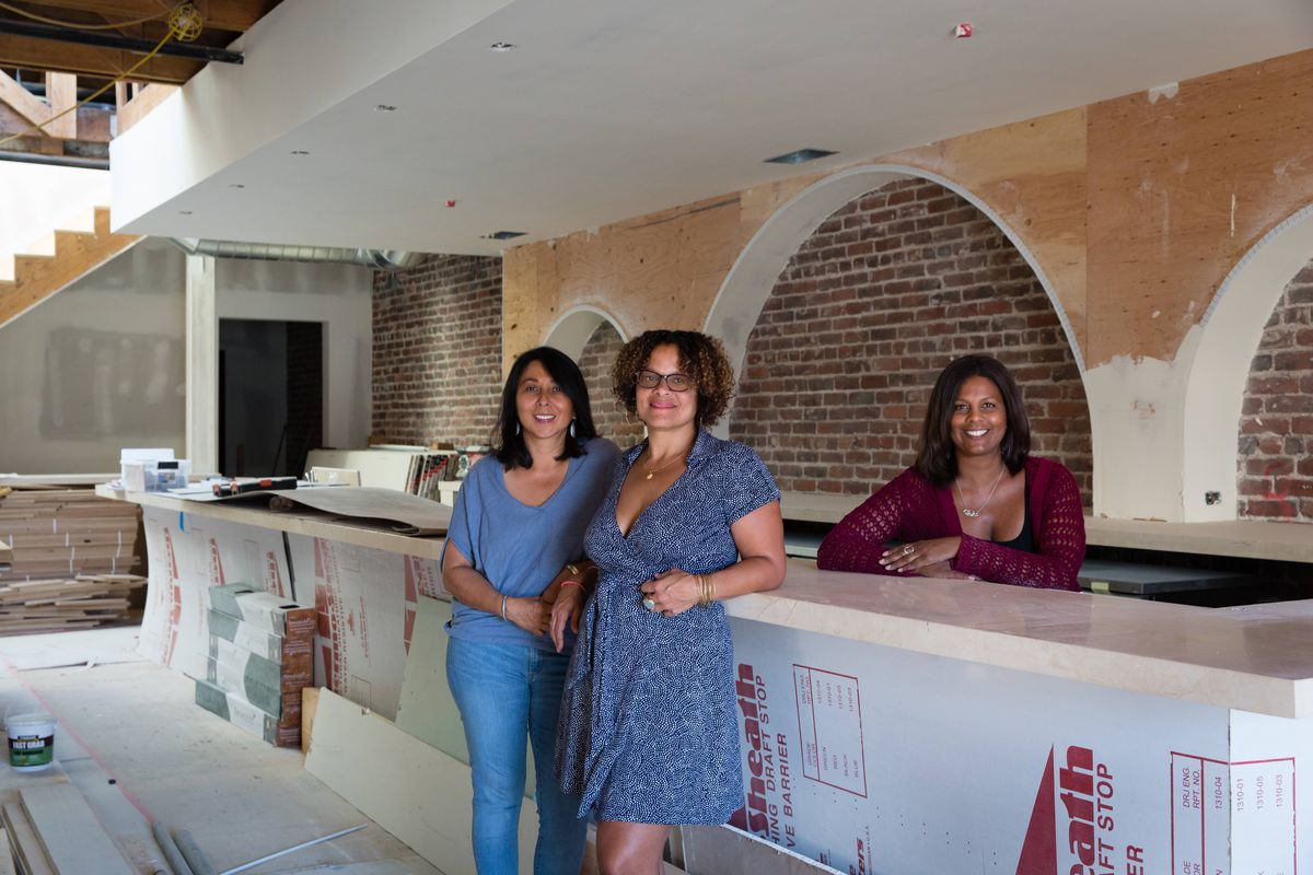 Anna Villalobos (left), Sandra Davis, and Lea Redmond stand at the bar counter of Oeste during the bar's buildout