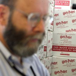 """Mark Gardiner preparing for the sale of """"Harry Potter and the Deathly Hallows"""" in 2007. The King's English was one of the first bookstores in Utah to sell the Harry Potter books, which is celebrating the 20th anniversary of the U.K. publication of the first book in the series on June 26."""