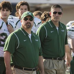 """Jim Caviezel (center-right) and Michael Chiklis (center-left) in """"When the Game Stands Tall."""""""
