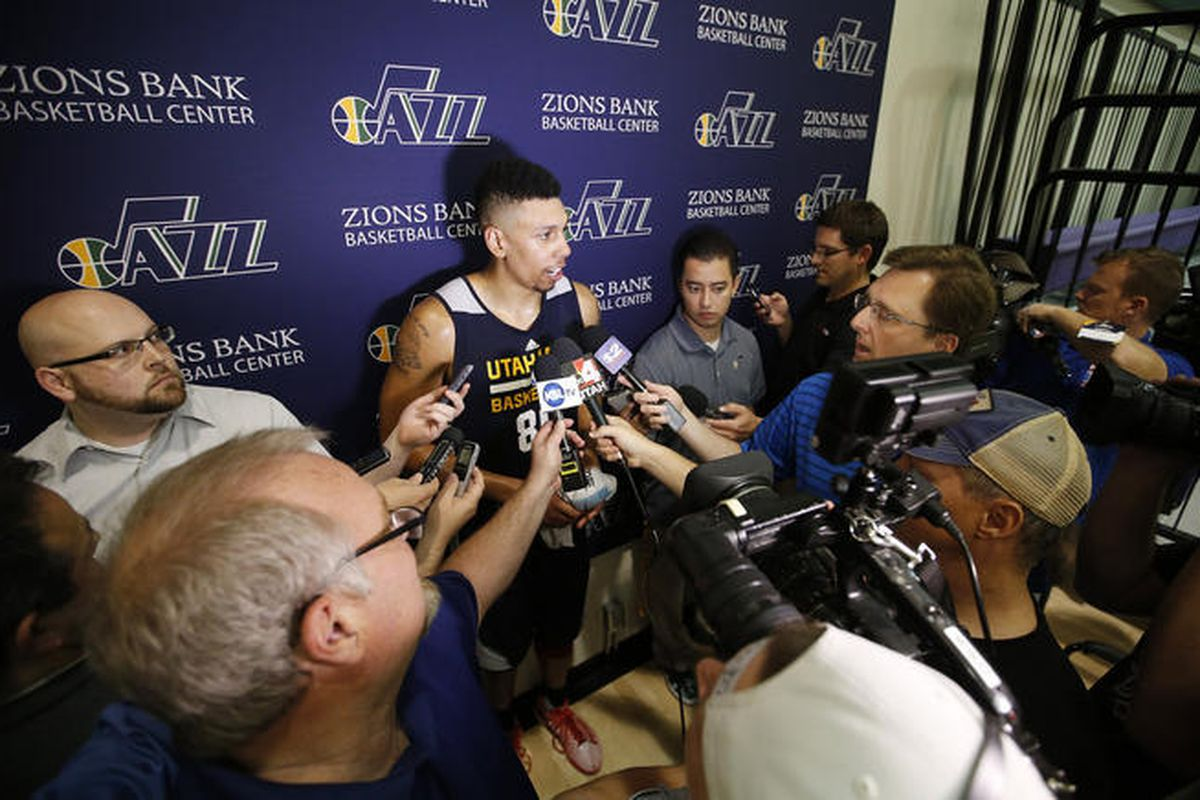 West Jordan native and former University of Utah player Jordan Loveridge meets with the media after his workout with the Utah Jazz.