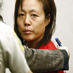 Sun Cha Warhola appears Friday in court in Davis County in the slayings of her two children.