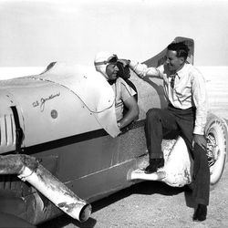 Ab Jenkins, former Mayor of Salt Lake City and famous race car driver siting in the Mormon Meteor on the Salt flats ready to set another speed record in the 1930's.