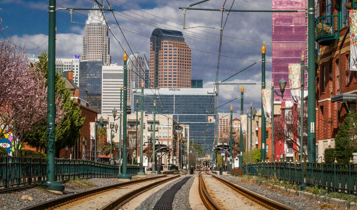 The train tracks of the LYNX light rail system in the residential neighborhood of South End lead into Uptown Charlotte.