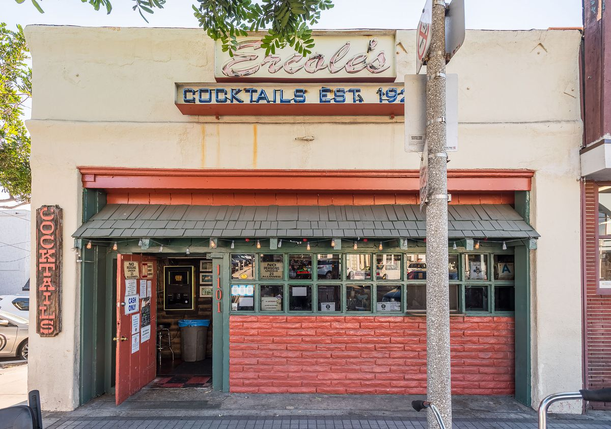 A historic dive bar with brick and signage.