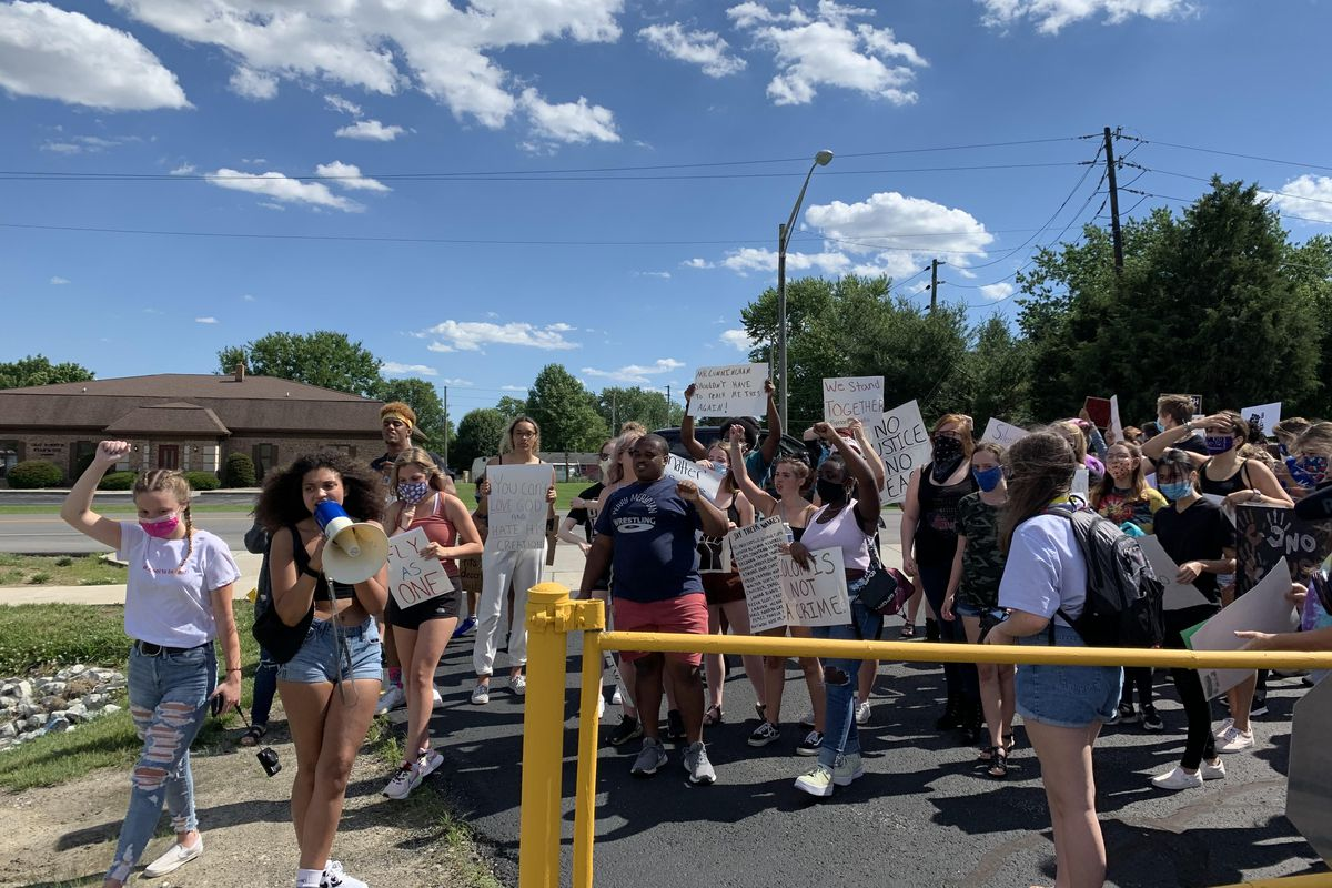 Kiara Moore leads Perry Township students in a chant June 11 as they rally for racial justice.