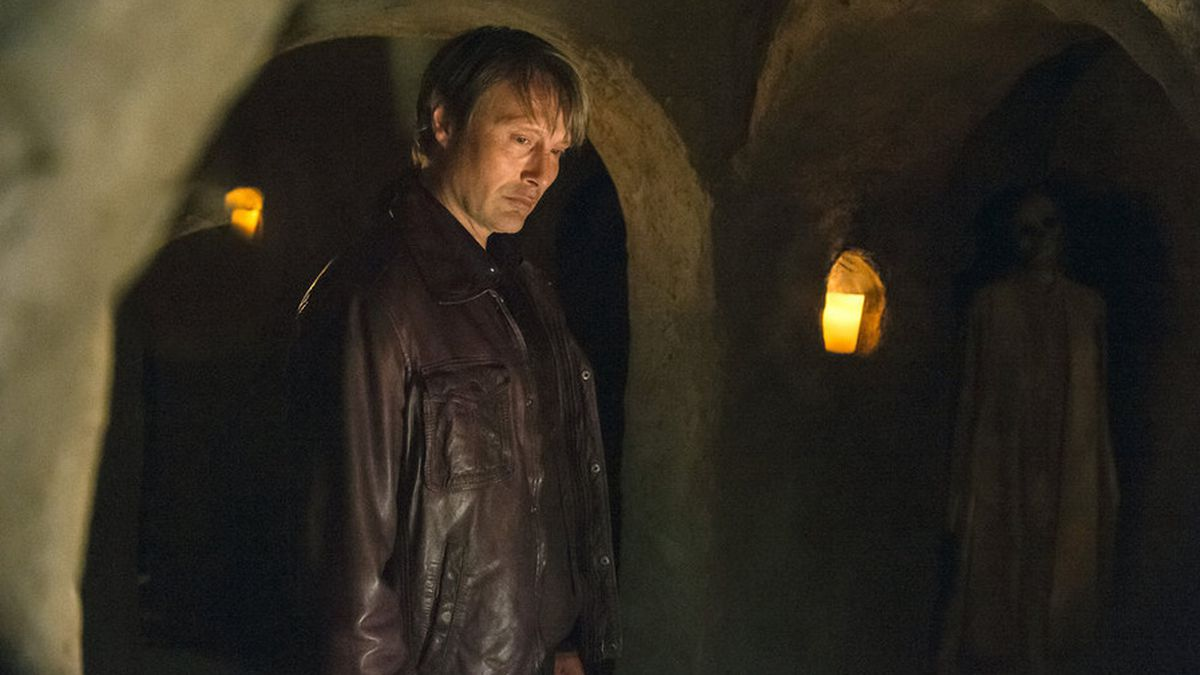 Hannibal Lecter (Mads Mikkelsen) slips into the catacombs in a scene from Hannibal's new season.