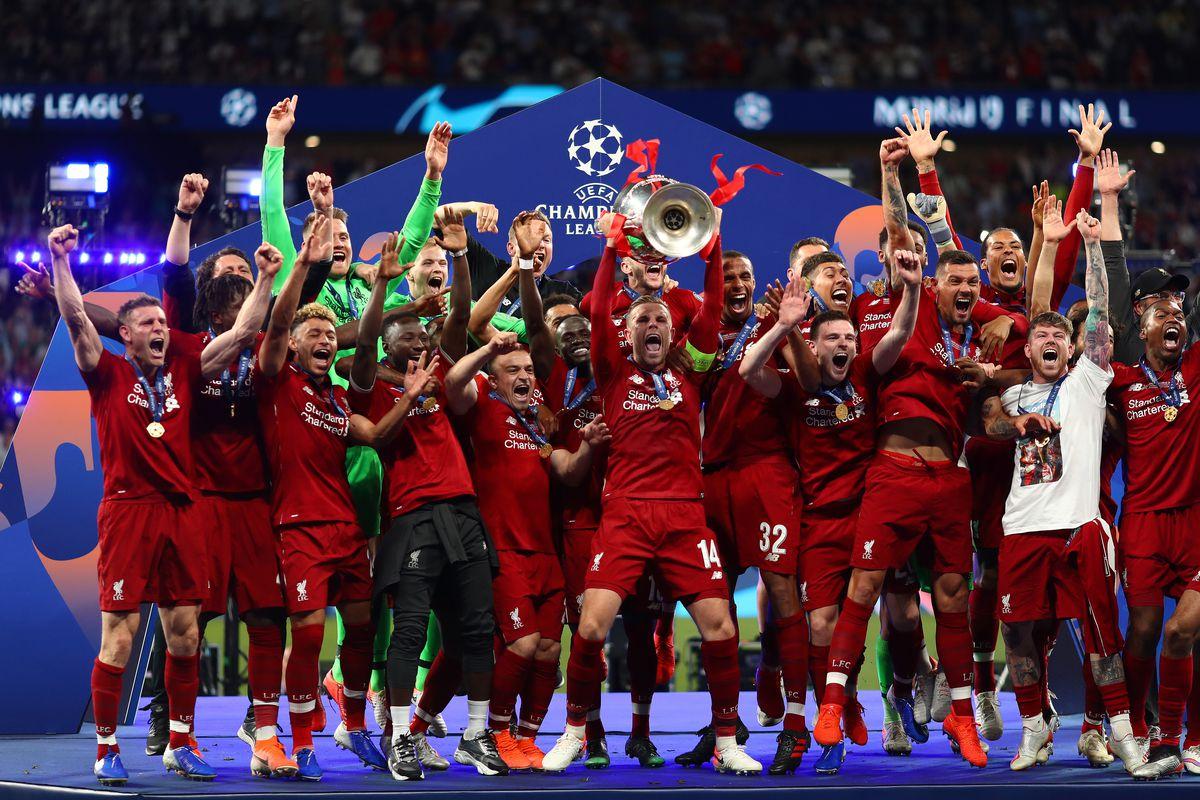 Jordan Henderson of Liverpool is seen lifting the trophy in...