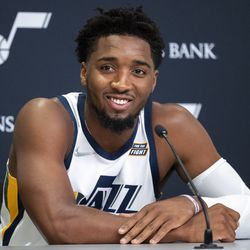 Utah Jazz guard Donovan Mitchell (45) smiles as he listens to a question during the Utah Jazz media day at Vivint Arena in Salt Lake City on Monday, Sept. 27, 2021.