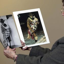 """Mary Immen Hall of Bennington, Vt., looks at the1940 Norman Rockwell illustration """"A Scout is Helpful"""" and the photograph it was created from at the Bennington Museum on Friday, Sept. 28, 2012, in Bennington, Vt. Hall modeled as the little girl in the illustration."""