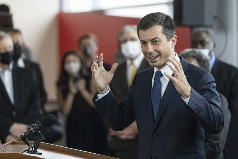 Transportation Secretary Pete Buttigieg speaks during a tour of the CTA Red Line 95th St/ Dan Ryan Station on Friday.