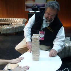 Drew Nieporent considers the fragility of the Jenga tower.