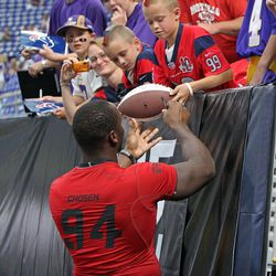 Aug 9, 2013; Minneapolis, MN, USA; Houston Texans defensive end Antonio Smith (94) signs an autograph for a fan prior to the game against the Minnesota Vikings at the Metrodome. The Texans defeated the Vikings 27-13.