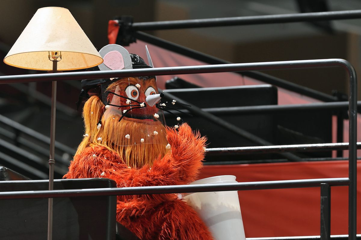 gritty the flyers mascot with a face shield and popcorn on his face