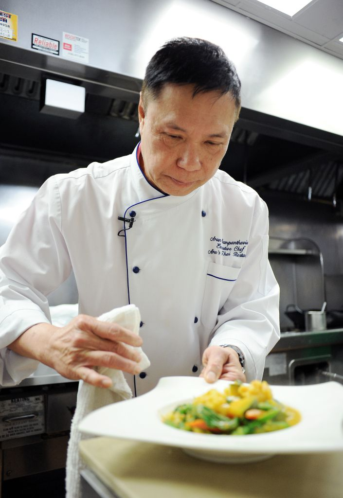 Arun puts the finishing touches on the prawn curry dish. | Victor Hilitski/For the Sun-Times