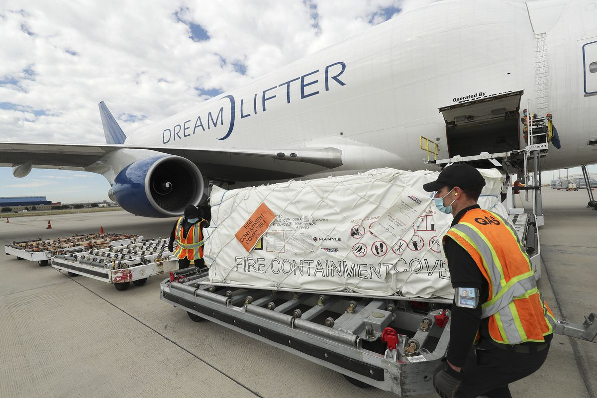 Crews unload a shipment of 500,000 protective face masks for Utah students and teachers at the Salt Lake City International Airport in Salt Lake City on Wednesday, July 1, 2020. The masks were delivered by a Boeing Dreamlifter.