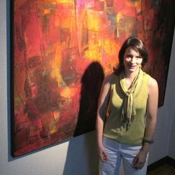 Lasley Steever, program and events manager at the Gibbes Museum of Art, stands by a painting by William Halsey in the museum in Charleston, S.C., on Wednesday, April 11, 2012. An image of the painting is one of more than 30,000 from art museums worldwide now available for viewing on the Internet through the Google Art Project. People can enter the Google Art Project site, see high resolution images and zoom in on details. It brings museum collections together in one place so art lovers don't have to go to various websites.