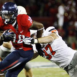 Arizona wide receiver Terrence Miller (18) runs against Oklahoma State linebacker Alex Elkins (37) during the first half of an NCAA college football game at Arizona Stadium in Tucson, Ariz., Saturday, Sept. 8, 2012.