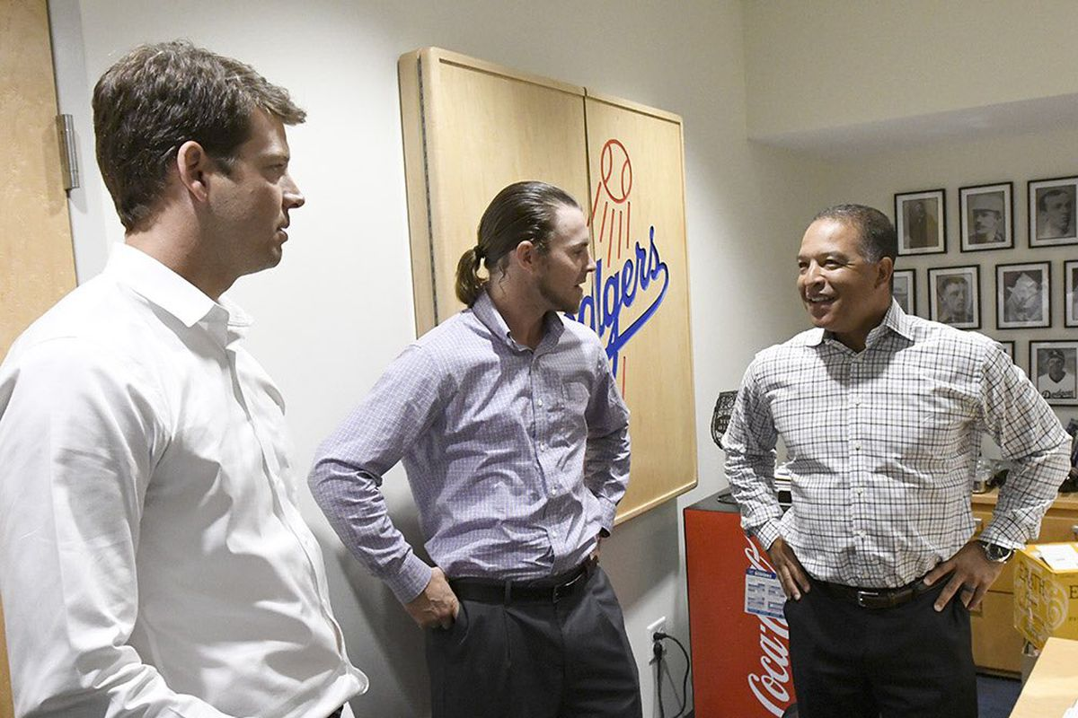 Rich Hill and Josh Reddick meet manager Dave Roberts after getting acquired by the Dodgers on Aug. 1.