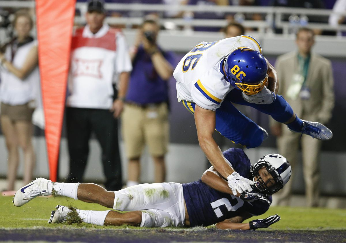 FORT WORTH, TX:  South Dakota State Jackrabbits tight end Dallas Goedert (86) reels in a touchdown over TCU Horned Frogs safety Niko Small (2) at Amon G. Carter Stadium.