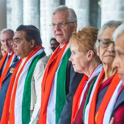 Elder D. Todd Christofferson, a member of the Quorum of Twelve Apostles for The Church of Jesus Christ of Latter-day Saints, center, and his wife, Sister Kathy Christofferson, beside him, join other dignitaries in attending the 71st Independence Day celebrations at the MIT World Peace University in Pune, Maharashtra, India, on August 15, 2017.