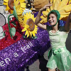Phoebe Romney dances with the Sunflower Dancers in the Days of '47 Parade through downtown Salt Lake City on Saturday.
