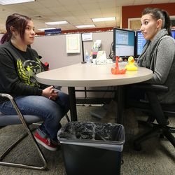 Audra Eagle talks with employment counselor Sarah Guzman about what she needs to do next to try to find employment during a meeting at the Utah State Metro Employment Center in Salt Lake City on Friday, Dec. 11, 2015.