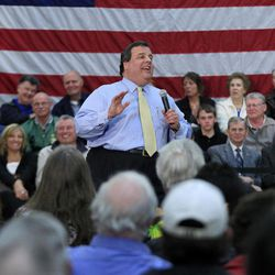 In this March 29, 2012 photo, New Jersey Gov. Chris Christie laughs as he addresses a crowd at a town hall meeting in Manchester, N.J. Part stump speech, part quiz show, part comedy hour, Chris Christie's town halls are probably not what Norman Rockwell envisioned in his famous 1943 painting of an assembly where people come to air their grievances and an elected official listens patiently. Yet the time-old tradition of the town hall has become the hallmark of Christie's administration and helped make him a rising Republican star.