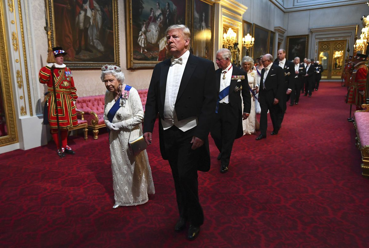 President Donald Trump and Queen Elizabeth II lead a procession of guests through the East Gallery toward the ballroom of Buckingham Palace for a state banquet on June 3, 2019.