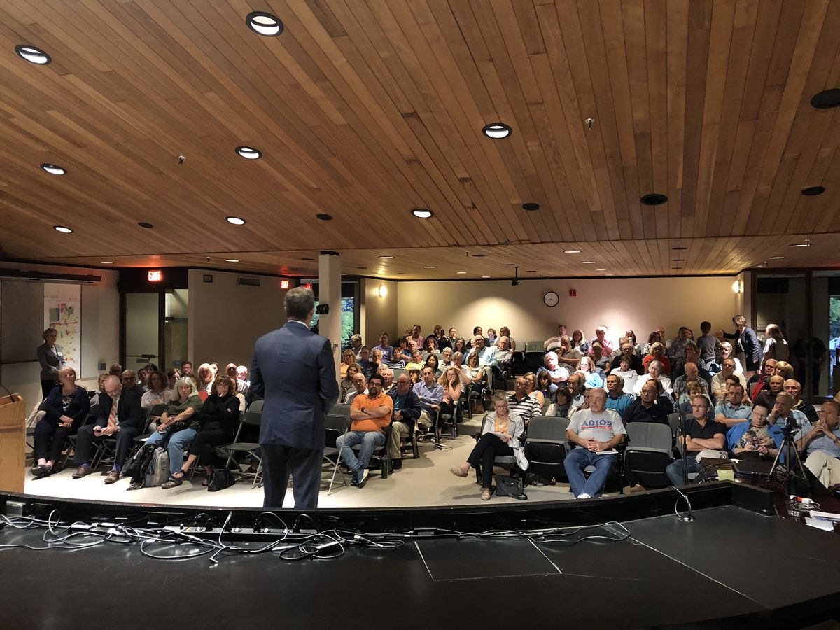 Rep. Sean Casten, D-Ill., discusses why he backs an  impeachment inquiry of President Donald Trump to a full house Wednesday at a town hall event in west suburban Downers Grove.