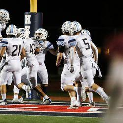 Westlake players celebrate after scoring a touchdown against Herriman at Herriman High School in Herriman on Friday, Sept. 4, 2020.