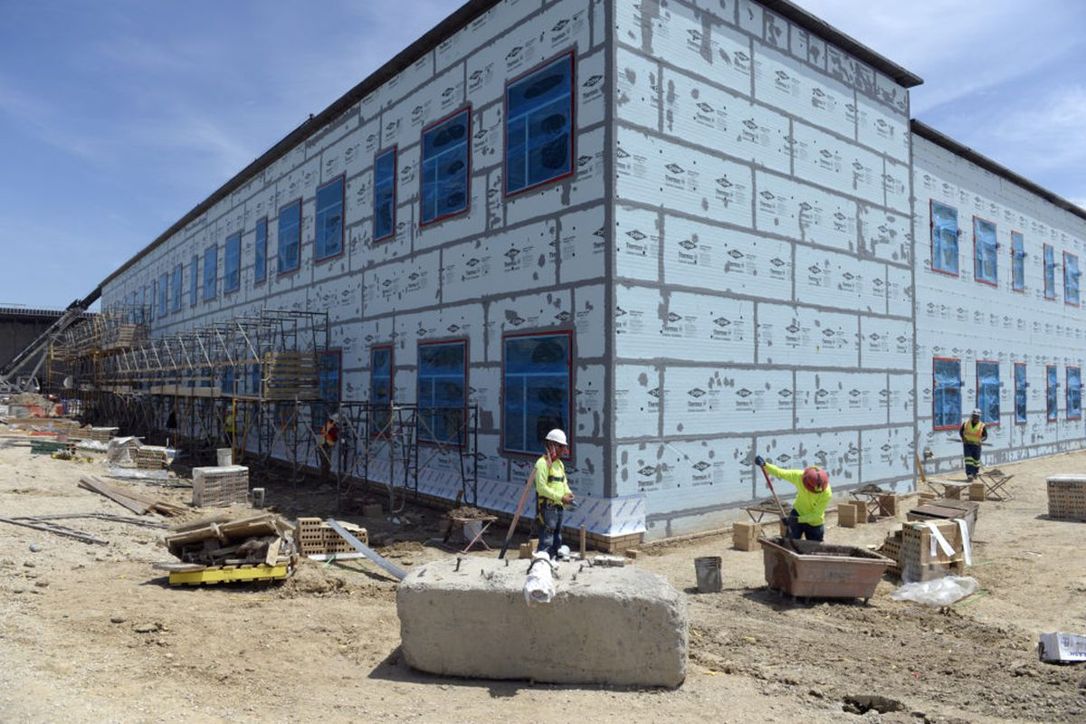 Construction crews work on Riverdale Ridge High School in Thornton, the newest in the Brighton 27J School District in May 2017.