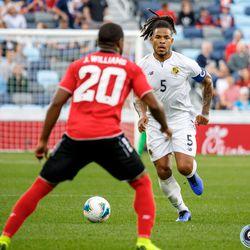 June 18, 2019 - Saint Paul, Minnesota, United States - Trinidad And Tobago midfielder Jomal Williams (20) marks Panama defender Roman Torres (5) during the Panama vs Trinidad and Tobago match at Allianz Field.
