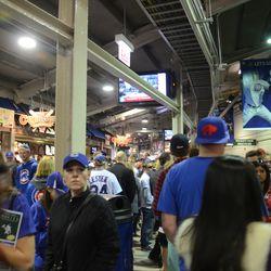 6:02 p.m. Crowded Wrigley Field concourse -