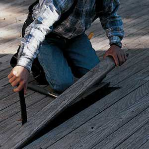 <p>Use a pry bar to pull damaged boards. Remove fasteners and lift the board straight up to avoid damaging adjacent boards.</p>