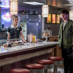 """Debora (Lily James) and Baby (Ansel Elgort) meet up at the diner in """"Baby Driver."""""""
