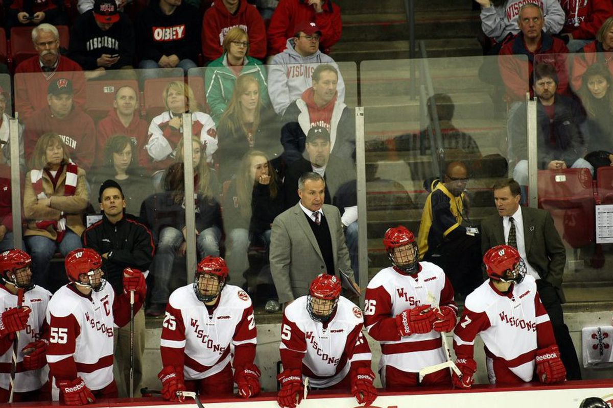 Bill Butters (center, gray jacket) will be replaced by UW alumni Matt Walsh on the Badgers' bench