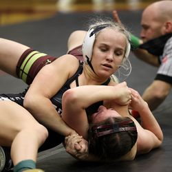Sage Mortimer of American Leadership Academy pins Donna Wright of Maple Mountain as they wrestle in the 115 weight class at the 5A/3A/2A/1A girls wrestling state championship meet at Mountain View High School in Orem on Wednesday, Feb. 17, 2021.