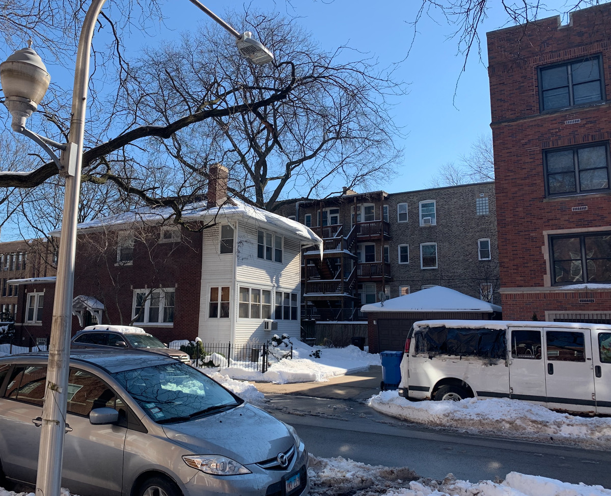 This photo shows how close a Catholic elementary school in Hyde Park is to an Augustinian monastery that housed two priests facing allegations of child sex abuse. At the far right of photo is the edge of the friary. On the far left is the edge of the school.