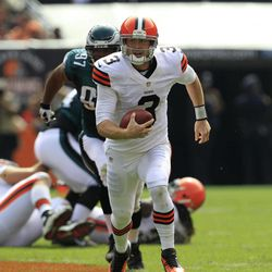 FILE - In this Sept. 9, 2012 file photo, Cleveland Browns quarterback Brandon Weeden (3) runs the ball in the second quarter of an NFL football game against the Philadelphia Eagles in Cleveland. Weeden had one of the worst debuts in NFL history, a 5.1 rating. Cleveland's defense forced five turnovers, but couldn't get the one it needed to stop Michael Vick. It added up to another tough loss, but one that showed some promise for a young team.