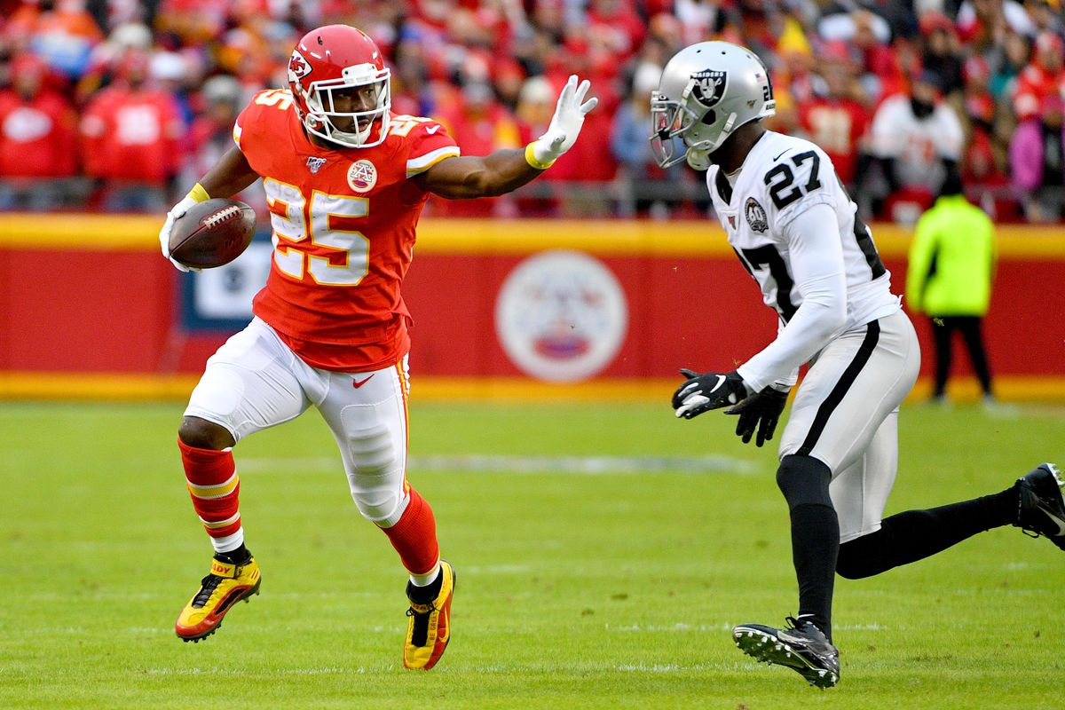 Kansas City Chiefs running back LeSean McCoy runs the ball as Oakland Raiders cornerback Trayvon Mullen defends during the game at Arrowhead Stadium.