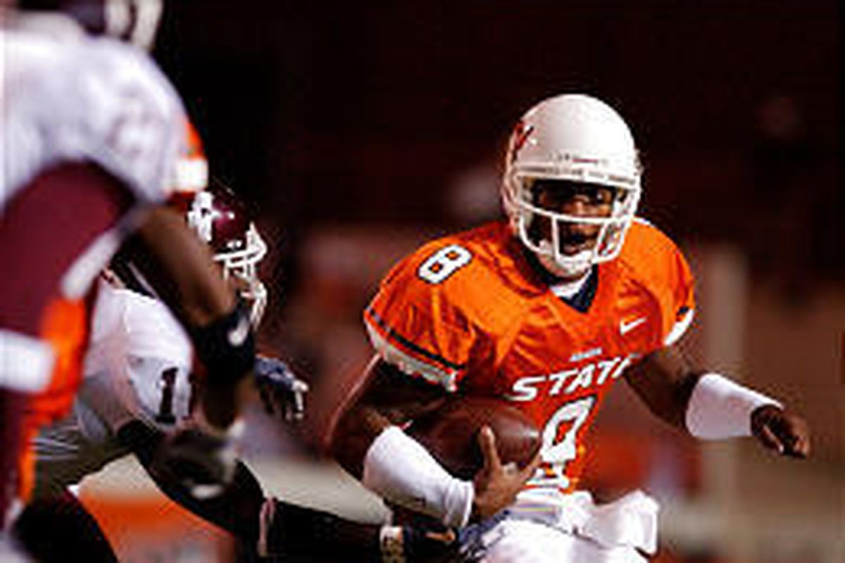 Oklahoma State quarterback Donovan Woods looks for running room during first-half action against Texas A and M Saturday in Stillwater, Okla. The Aggies won.