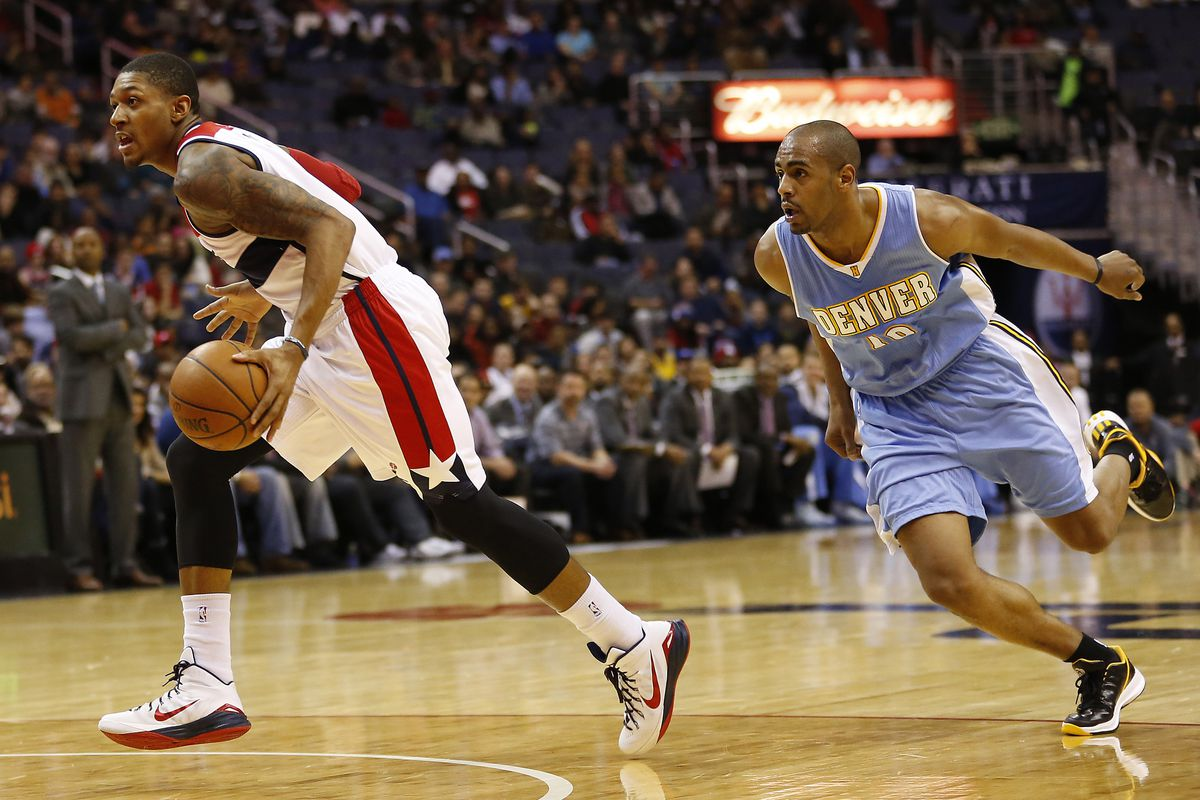 Bradley Beal's (L) offensive onslaught early set the tone against a lax Denver Nuggets team.