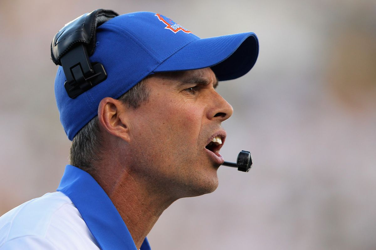 Head coach Chris Petersen of the Boise State Broncos leads his team against the Colorado State Rams at Sonny Lubick Field at Hughes Stadium on October 15, 2011 in Fort Collins, Colorado.  (Photo by Doug Pensinger/Getty Images)