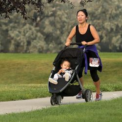 Weihong Wang pushes her son Sammy in a stroller as she nears the finish of the Labor Day Pun Run at Olympic Park in Lehi on Monday, Sept. 7, 2020. The fifth annual event raises awareness for those who face unplanned pregnancies and provides community support to the Pregnancy Resource Center of Salt Lake City. This nonprofit organization is celebrating 34 years of offering free services to mothers, fathers and families.