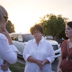 Karen Newton, left, Kathy Stidham and Sarah Stidham talk outside an LDS meetinghouse in Sandy on Thursday, June 8, 2017, after an interfaith gathering to comfort the community following Tuesday's deadly shooting.