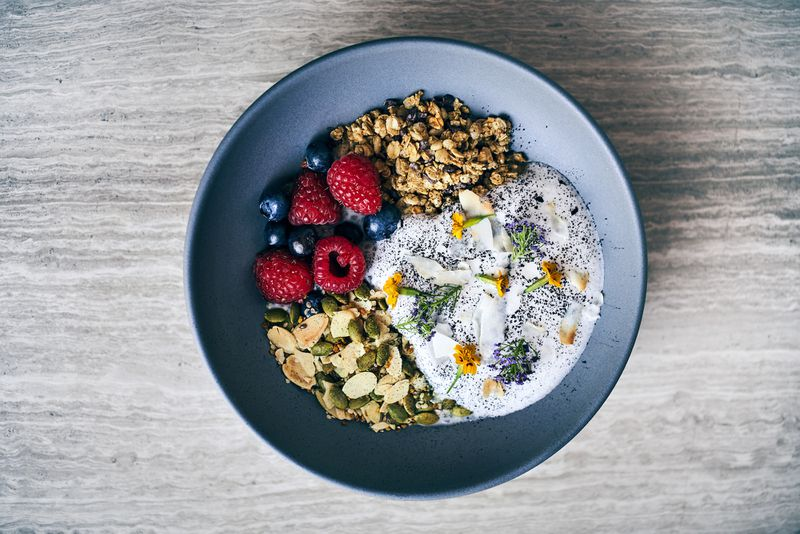 A bowl of chia and grains for breakfast, with berries.