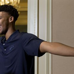 Tony Bradley, who was selected by the Utah Jazz in last Thursday's NBA draft, shows his wingspan while speaking to a reporter at the Grand America Hotel in Salt Lake City on Wednesday, June 28, 2017.