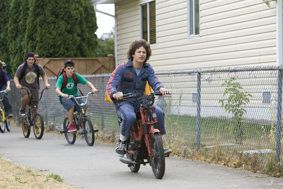 andy samberg leads a pack of kids riding bicycles in Hot Rod