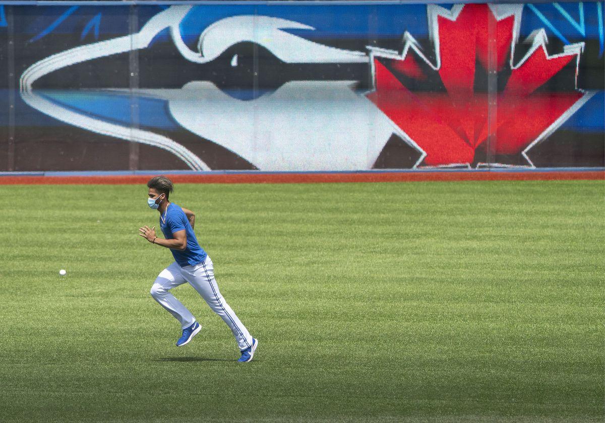 Toronto Blue Jays left fielder Lourdes Gurriel Jr. (13) warms up during summer workout at Rogers Centre.